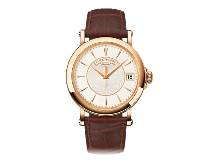 Patek Philippe Calatrava men's 18k rose gold mechanical self-winding strap watch featuring date in an aperture with a silver dial. (5153R-001)