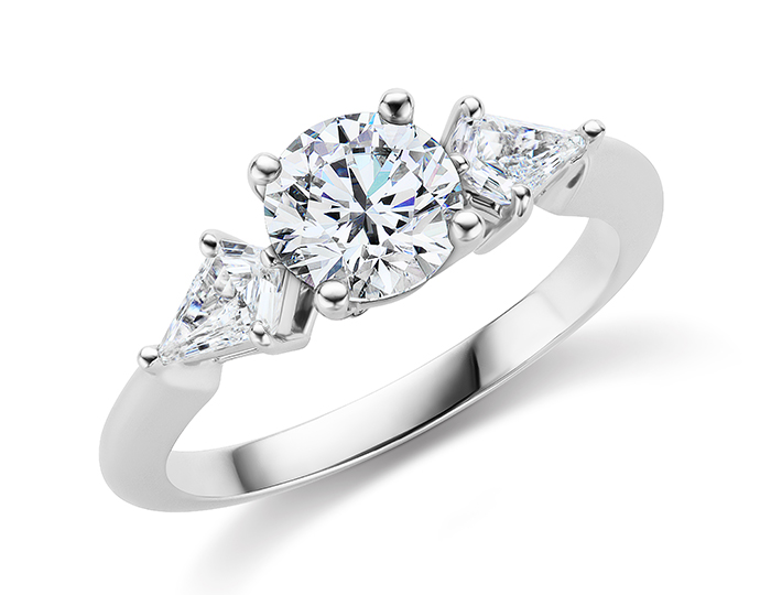Round brilliant cut center diamond and kite shape diamond engagement ring in platinum.