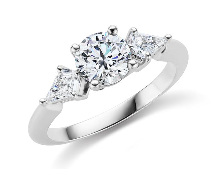 Round brilliant cut center diamond and kite shape diamond engagement ring in platinum.