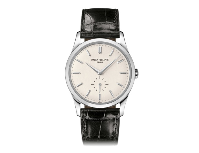 Patek Philippe Calatrava mens 18k white gold manually wound strap watch featuring a silvery dial with seconds subdial. (5196G-001)