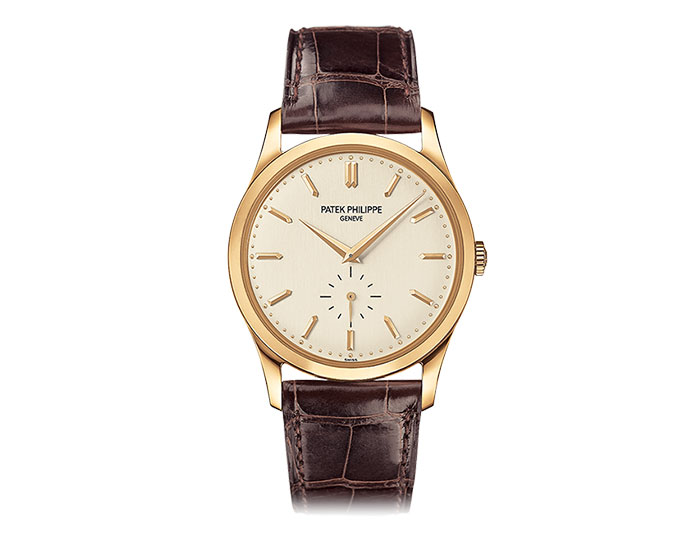 Patek Philippe Calatrava men's 18k yellow gold mechanical manual wound strap watch featuring seconds subdial with a white opaline dial. (5196J-001)