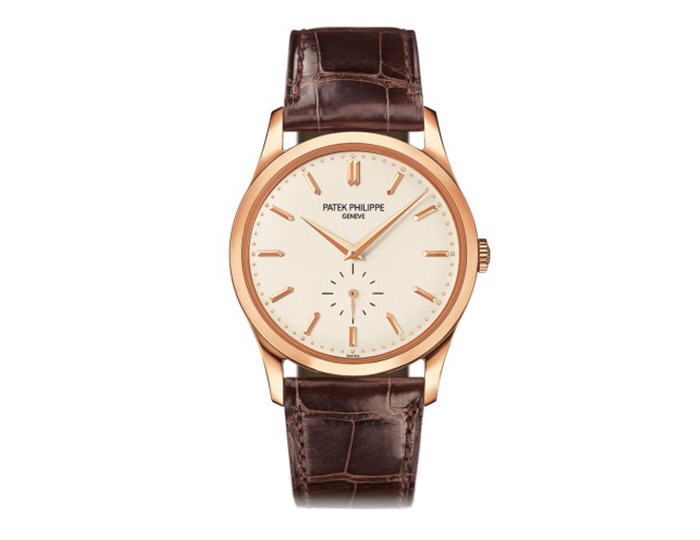 Patek Philippe Calatrava mens 18k rose gold manually wound strap watch featuring a silvery dial with seconds subdial. (5196R-001)