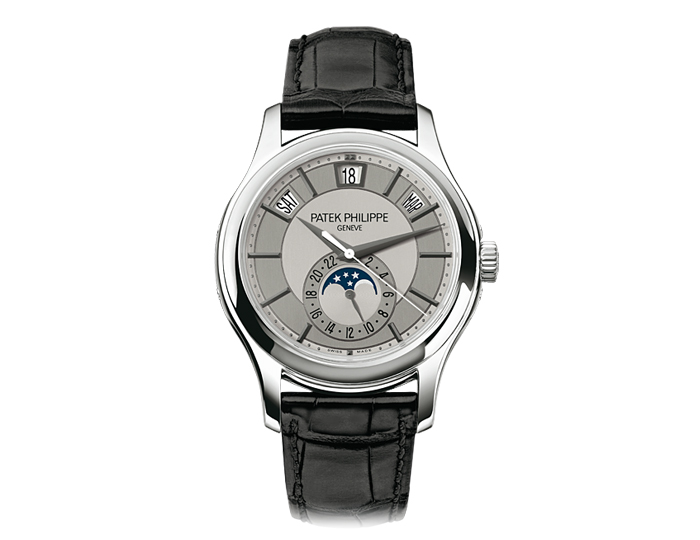 Patek Philippe annual calendar mens 18k white gold mechanical self-winding alligator strap watch featuring day, date and month in apertures, moon phases and 25-hour dial, with a rhodium and silver gray dial. (5205G-001)