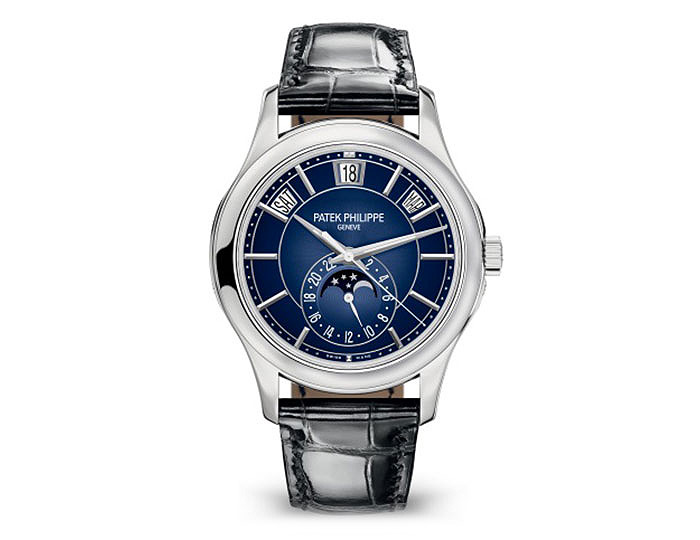 Patek Philippe Men's Annual Calendar, Moon Phase, self winding mechanical movement, 40MM case, in white gold, blue sunburst graduated black dial, alligator hand stitched shiny black strap with prong buckle.