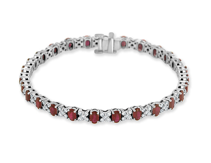 Oval ruby and round brilliant cut diamond tennis bracelet in 18k white gold.
