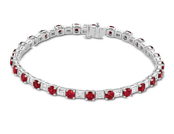 Ruby and baguette cut diamond bracelet in 18k white gold.