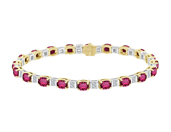 Oval shape ruby and baguette cut diamond bracelet in 18k yellow and white gold.