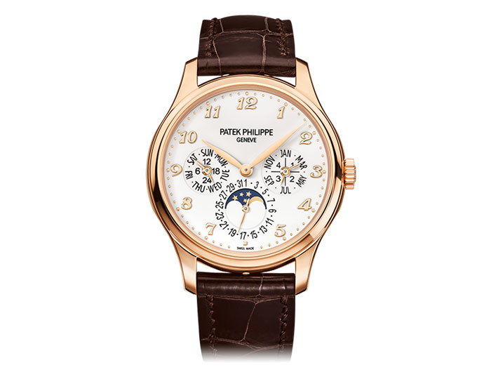 Patek Philippe perpetual calendar mens 18k rose gold mechanical self-winding strap watch featuring day, date, month, leap year by hands, moon phases and 24-hour indicator with an ivory lacquered dial.  (5327R-001)