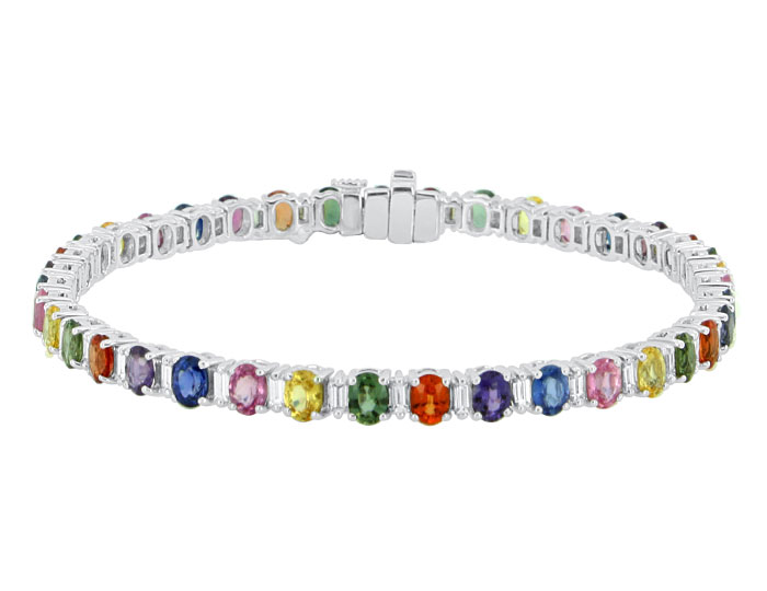 Oval fancy colored sapphire and baguette cut diamond bracelet in 18k white gold.