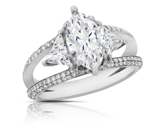 Marquise cut, trillion shape and round brilliant cut diamond engagement ring in platinum.