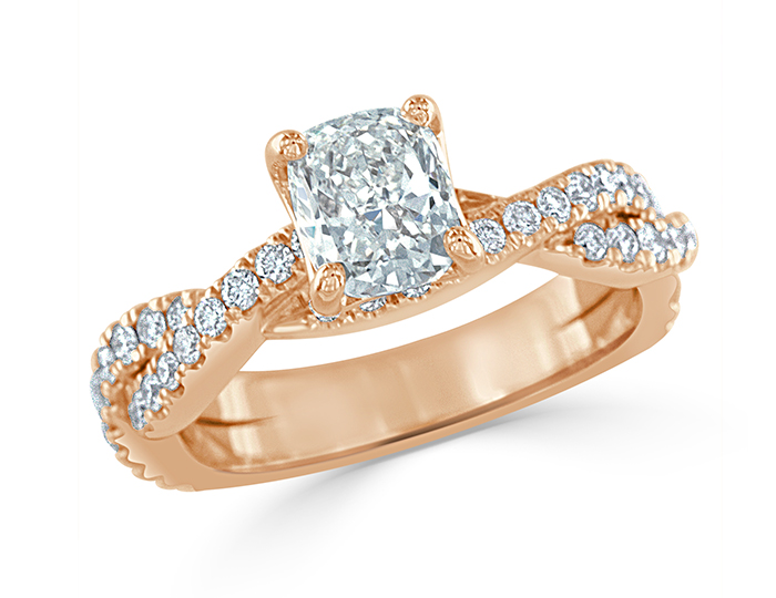Cushion cut and round brilliant cut diamond engagement ring in 18k rose gold.