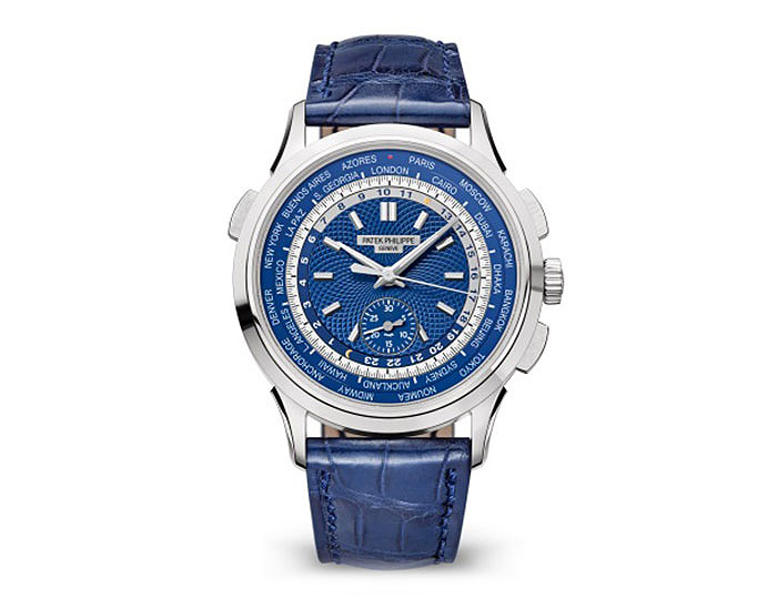 Patek Philippe World Time Chronograph self-winding movement, in white gold, 39.5mm case, blue dial with circular hand crafted guilloche pattern, blue strap with fold-over clasp.