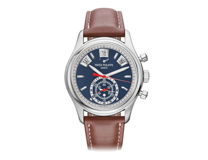 Patek Philippe mens 18k white gold mechanical self-winding leather strap watch featuring day, date and month in apertures, 60 minute and 12-hour monocounter with blue varnished dial. (5960/01G-001)