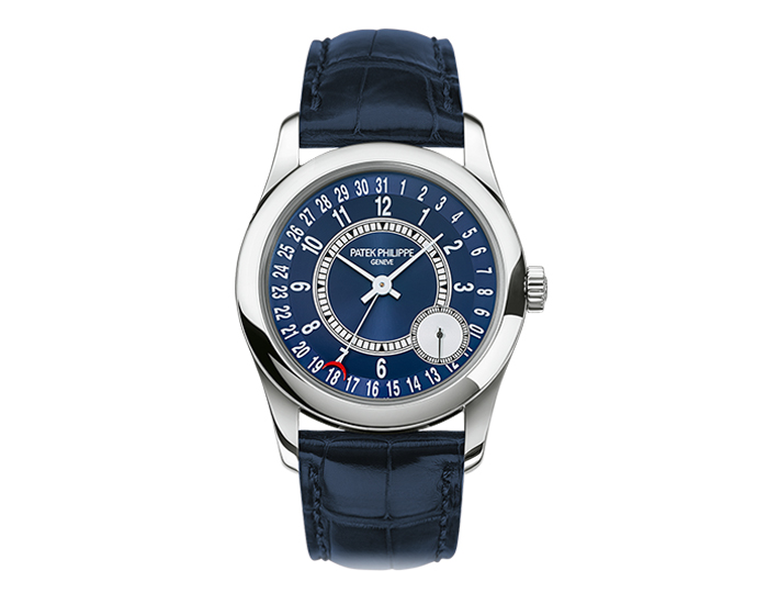 Patek Philippe Calatrava mens 18k white gold mechanical self-winding strap watch featuring date by hand and a seconds subdial with a blue sunburst and silvery gray dial. (6000G-012)