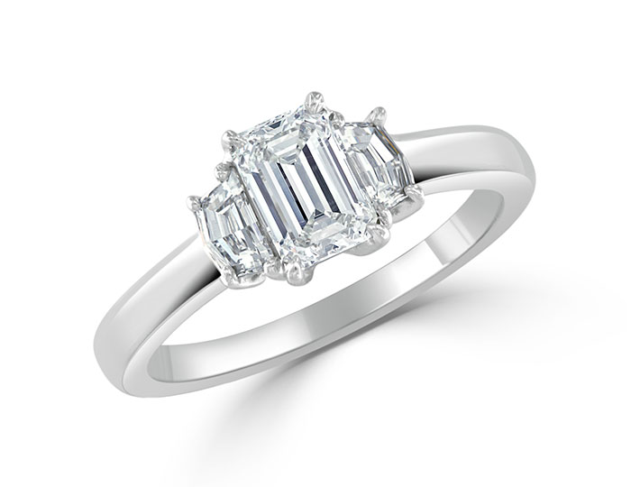 Emerald and caddie cut diamond engagement ring in platinum.
