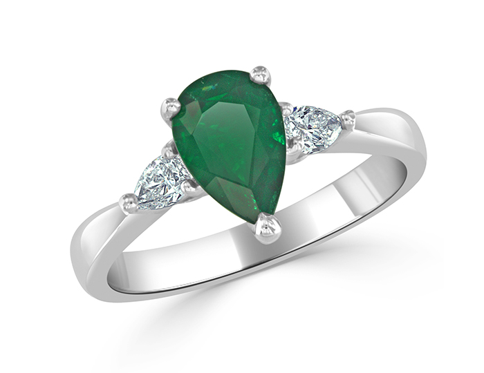 Pear shape emerald and diamond ring in platinum.