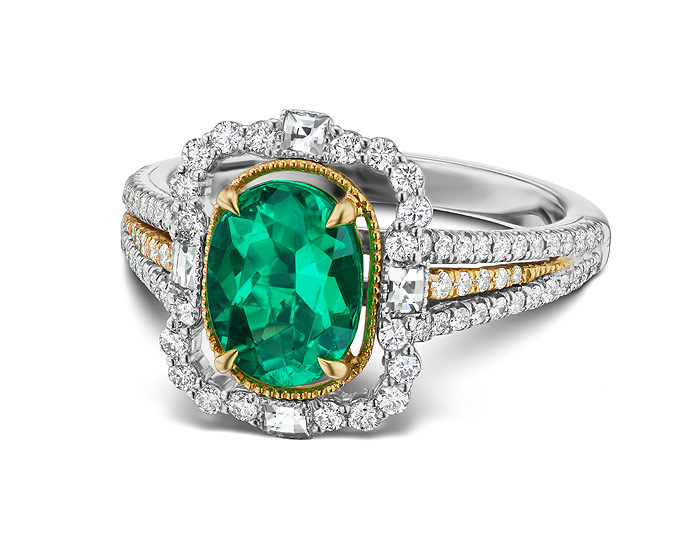 Oval emerald and round brilliant cut and blaze cut diamond ring in 18k white gold.