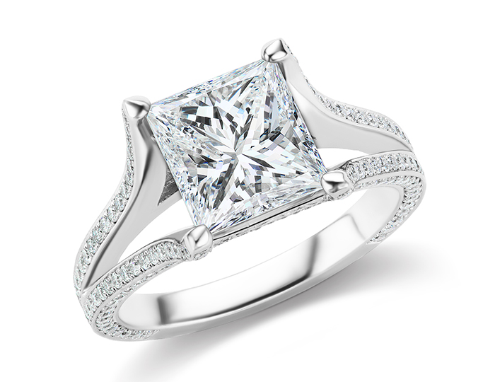 Princess cut and round brilliant cut diamond ring in platinum.