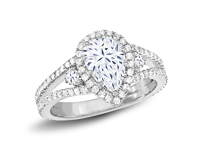 Pear shape and round brilliant cut diamond ring in platinum.