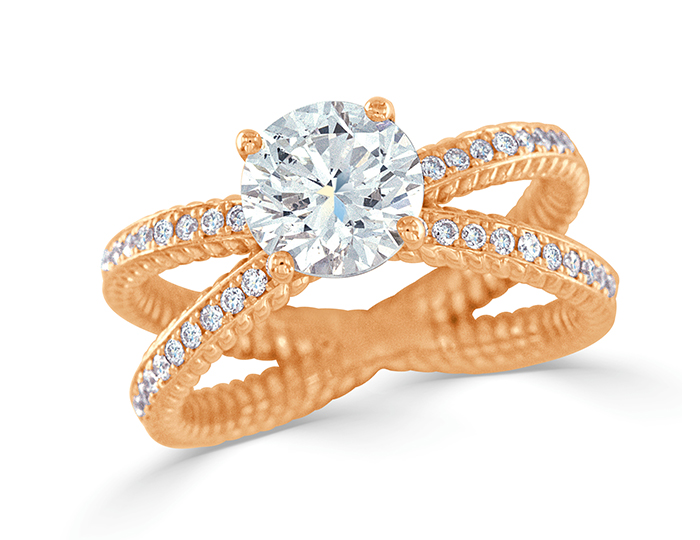 Round brilliant cut diamond engagement ring in 18k rose gold.