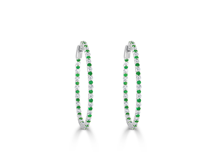 Round brilliant cut diamond and emerald earrings in 18k white gold.