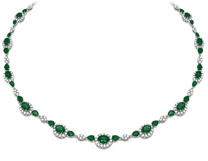Emerald and round brilliant cut diamond necklace in 18k white gold.