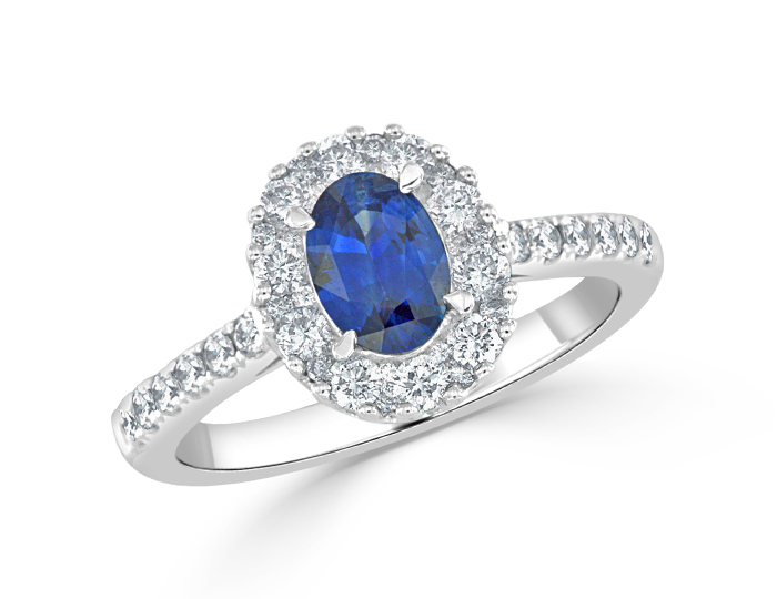 Oval sapphire and round brilliant cut diamond ring in 18k white gold.