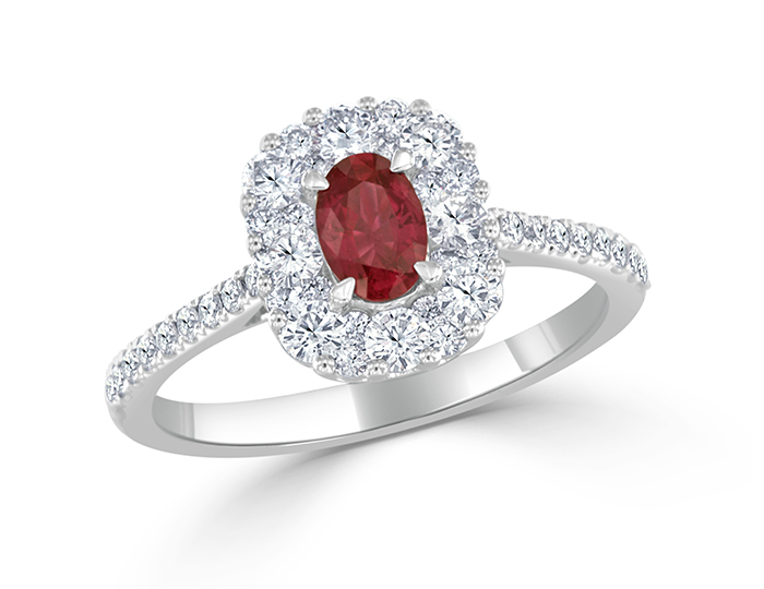 Oval cut ruby and round brilliant cut diamond ring in 18k white gold.