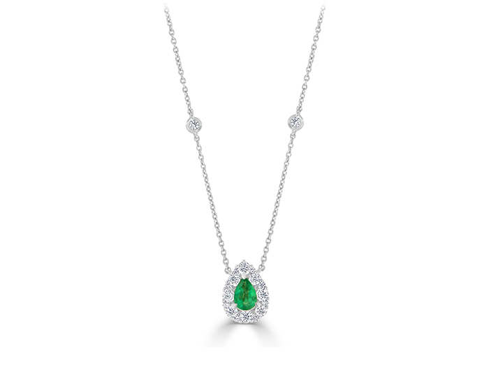 Pear shaped emerald and round brilliant cut diamond necklace in 18k white gold.
