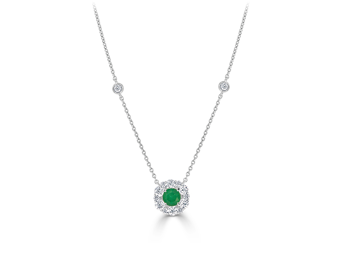Round brilliant cut emerald and diamond necklace in 18k white gold.