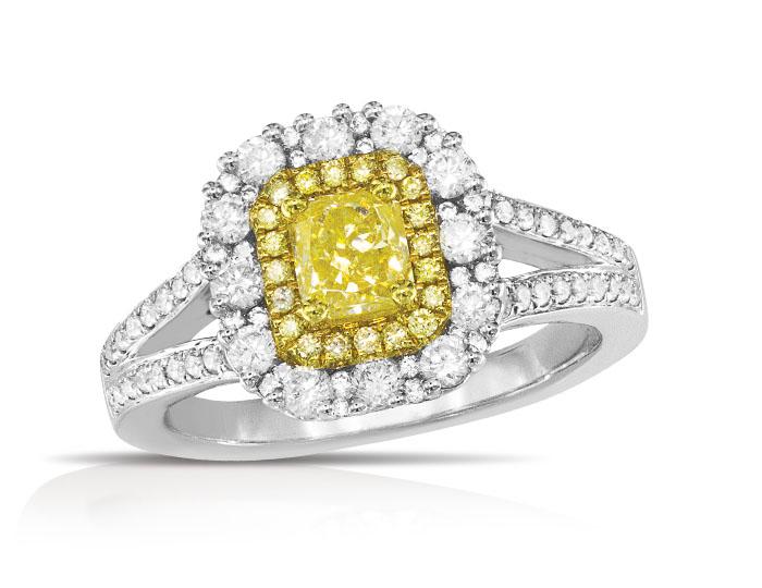 Yellow cushion cut and round brilliant cut white and yellow diamond ring in 18k white and yellow gold.
