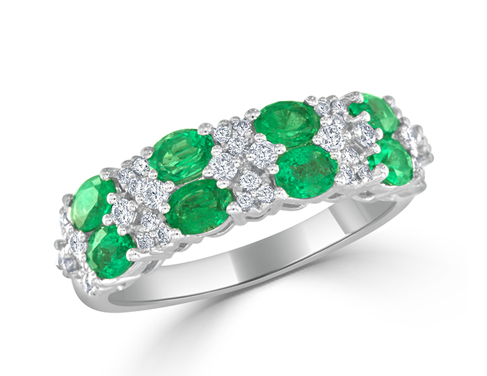 Oval cut emerald and round brilliant cut diamond band in 18k white gold.
