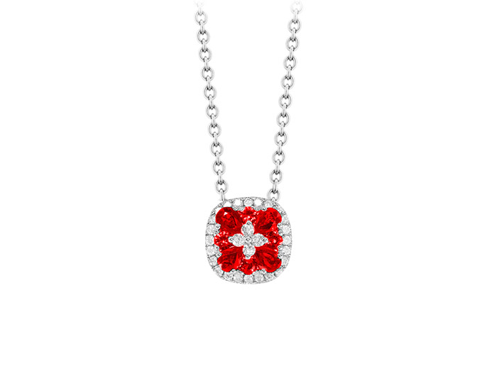 Ruby and round brilliant cut diamond pendant in 18k white gold.