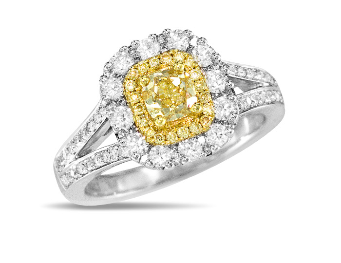 Yellow diamond and round brilliant cut diamond ring in 18k white and yellow gold.