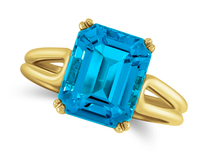 Blue topaz ring in 18k yellow gold.