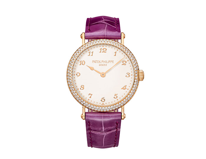 Patek Philippe ladies ultra thin mechanical self winding movement Caliber 240 silvery grained dial with gold applied Breguet numerals in 18 karat rose gold, case set with 142 diamonds, water resistant 30m, on purple strap with 26 diamond prong buckle.