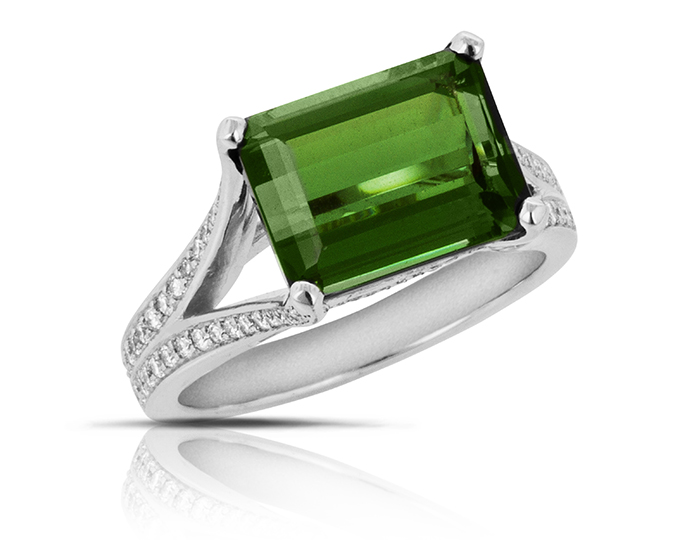 Green tourmaline and round brilliant cut diamond ring in 18k white gold.