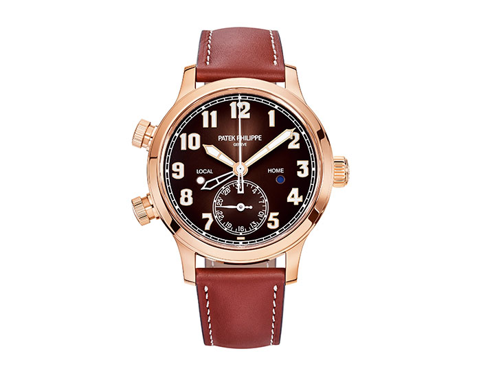 Patek Philippe Women's Pilot Travel Time, mechanical self-winding movement, 18 karat rose gold, 37.5mm case, brown sunburst dial with Arabic numerals and luminescent coating, calfskin vintage brown strap with Clevis prong buckle.