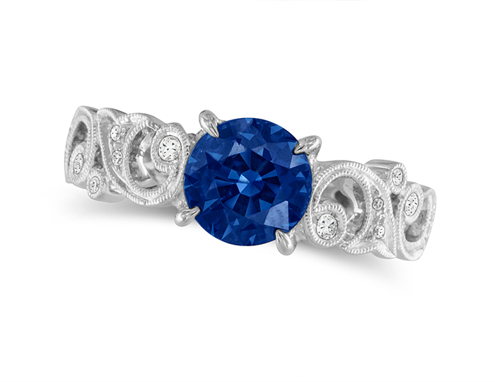 Sapphire and round brilliant cut diamond ring in platinum.