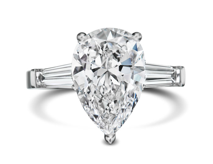 Pear and baguette cut diamond engagement ring in platinum.