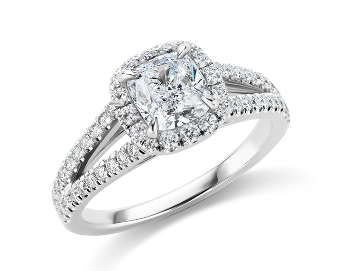 Cushion cut and round brilliant cut diamond engagement ring in platinum.