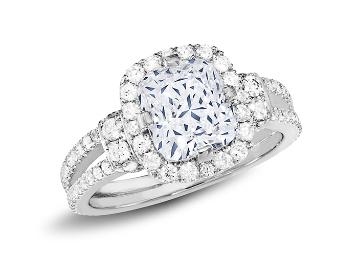 Cushion and round brilliant cut diamond engagement ring in platinum.