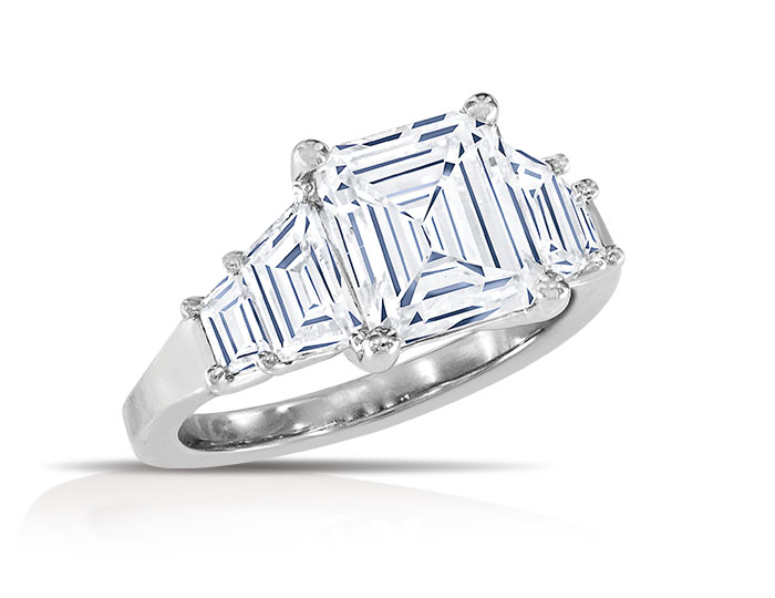 Emerald cut and trapezoid cut diamond engagement ring in platinum.