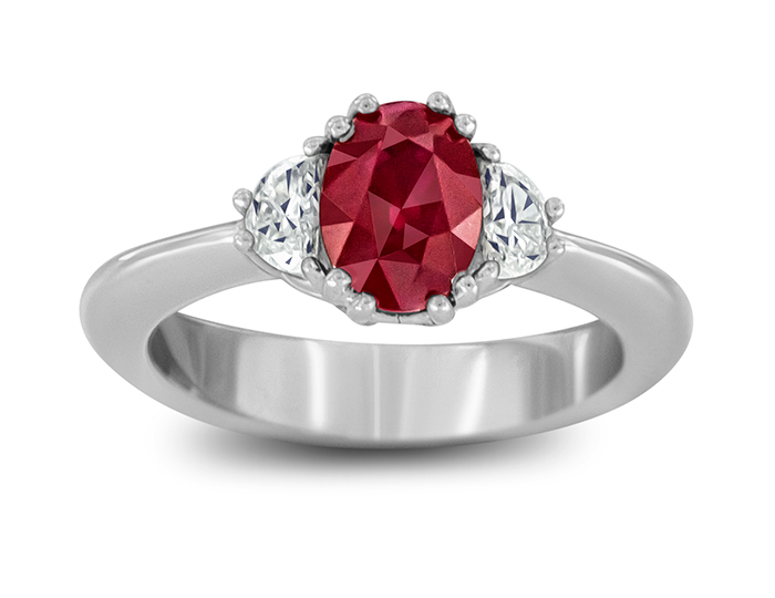 Ruby and half-moon shape diamond ring in platinum.