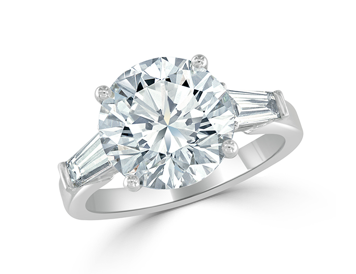 Round brilliant and baguette cut diamond engagement ring in platinum.