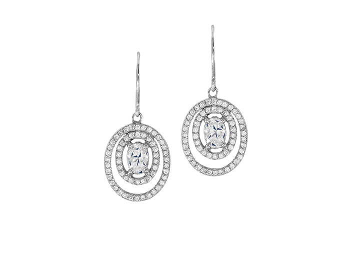 Oval and round brilliant cut diamond earrings in platinum.