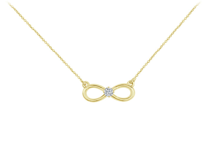 Round brilliant cut diamond necklace in 18k yellow gold.