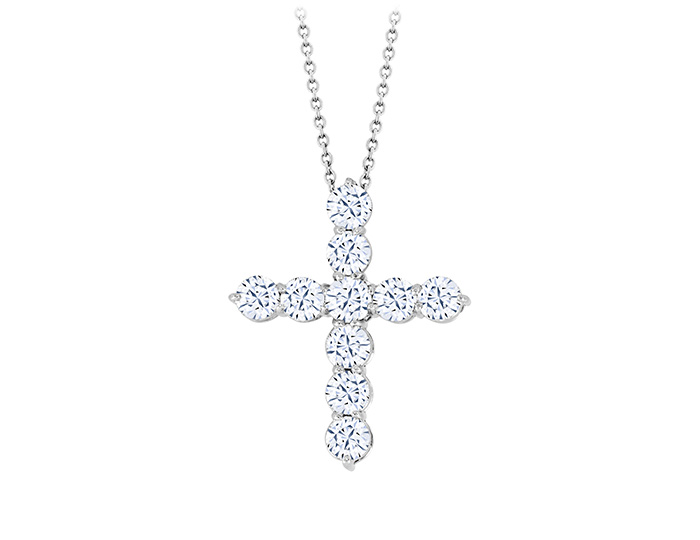 Round brilliant cut diamond cross in platinum.