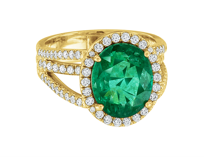 Emerald and round brilliant cut diamond ring in 18k yellow gold.