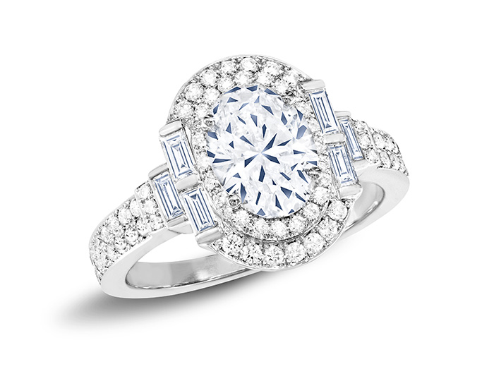 Oval cut, baguette cut and round brilliant cut diamond engagement ring in platinum.